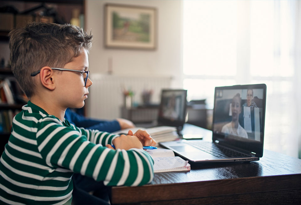 Boy learning on his laptop